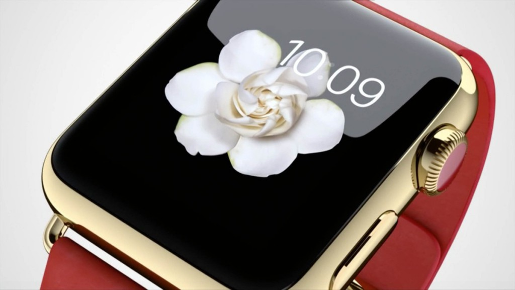 Gold apple watch with red band